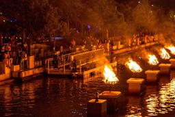 On-lookers enjoy the bonfires at the WaterFire art installation in Providence RI