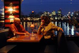 Couple Sitting At Booth Enjoying View