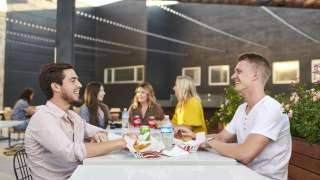 Friends Eating at Restaurants in Sandy