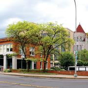 Panorama of Blue Skies and Green Trees Featuring Weighlock Building