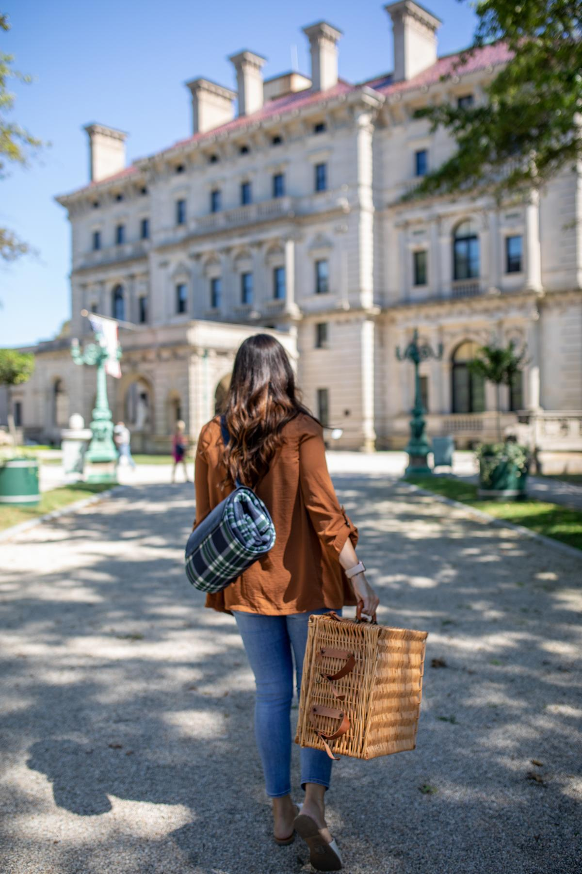 Woman With Bag Walking To Newport Mansion