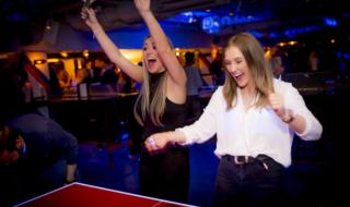 Women play ping pong