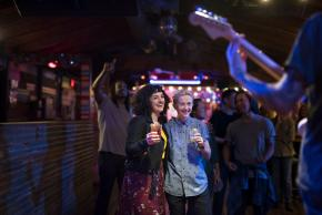 Couple watching live music show at Cheer Up Charlies in Austin Texas