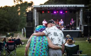 Couple watching Them Coulee Boys at Blue Ox Music Festival: Campout in the Pines