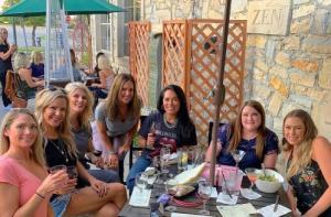 Ladies enjoying wine on the patio at Zin Zen Wine Bistro
