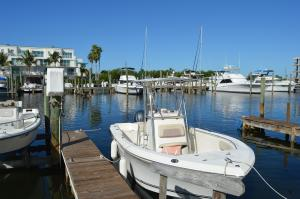 Small white boat next to a dock at Cape Haze Marina in Englewood, FL