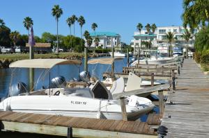 Sunny day view of a long dock with boats at Cape Haze Marina in Englewood, Florida