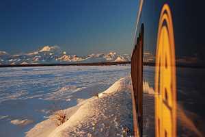 Alaska Railroad train with Denali in Winter