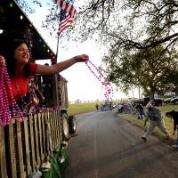 Women throwing Mardi Gras beads
