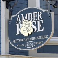 Amber Rose Restaurant and Catering blue and white sign