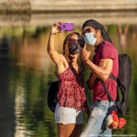 Masked Couple Posing for a selfie at Lake Merritt