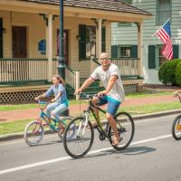 Family biking in Historic Village