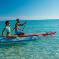 Couple paddleboarding