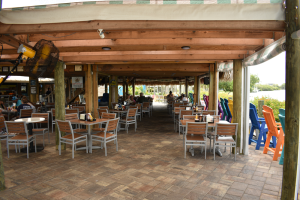 Outside dining under the Tiki at Lighthouse Grill at Stump Pass