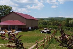 Big Hill Ciderworks Building With Truck On The Grass In The Cumberland Valley