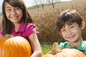 Children show off their perfect Halloween pumpkin picks at a Cumberland Valley pumpkin patch.