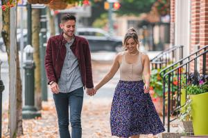 Couple holding hands walking the street in Carlisle