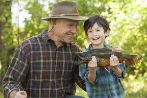 Grandfather and Grand Son catch a fish