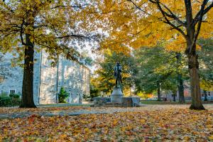 The Dickinson College campus statue surrounded by fall foliage