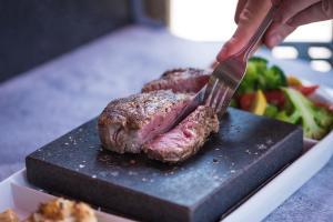 Flinchy's steak on a hot volcanic stone