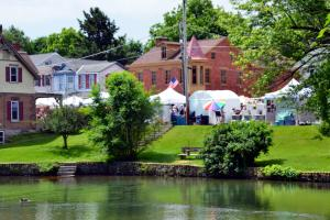White tents and pond at the Foundry Day Arts and Crafts Festival in Boiling Springs, PA