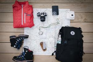 An artful image of hiking gear and photography equipment.