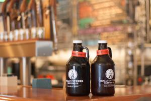 Growlers sitting on the bar at Molly Pitcher Brewing Co in Carlisle