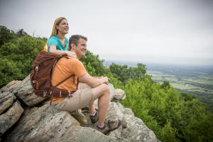 Hikers pause at a Waggoner's Gap overlook to admire the breathtaking views.