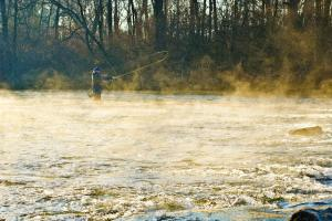 Man Standing In Lake Fly Fishing in Cumberland Valley