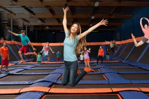 Kids and young adults jumping at SkyZone Trampoline Park