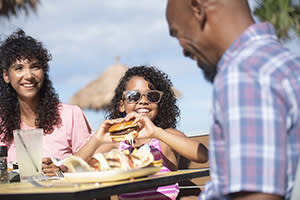 Family enjoying outdoor dining in Daytona Beach