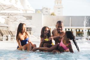 Claremont Hotel Pool Family Playing