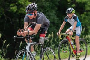 para athlete on bike for triathlon