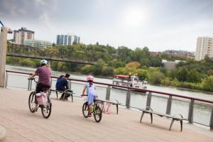 Family biking at River Landing