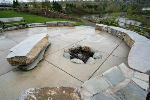 Seating area and fire pit at Duwamish Gardens