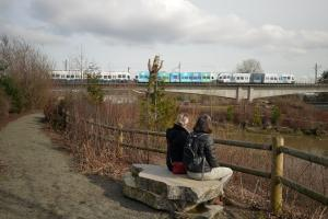 Two women sitting on stone bench at Duwamish Gardens