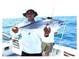 Fisherman holding a bonita fish