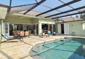 View of a lanai and pool at a vacation rental in Punta Gorda/Englewood Beach, FL
