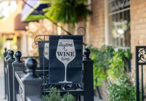 Banner Anytime is Wine Time hanging on patio at Lone Star Wine Cellars