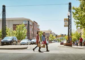 Smiling shoppers enjoy the fall sidewalk sale in Golden.