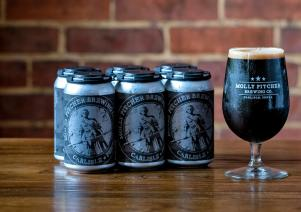 Pint and cans of the Peanut Butter Porter from Molly Pitcher Brewing Co.