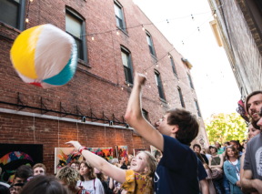 People With Beach Ball In Gallery Alley In Wichita, KS