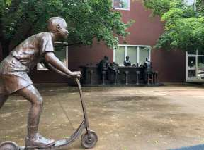 Bronze Sculpture of Sit-in with Boy on Scooter in Wichita, KS