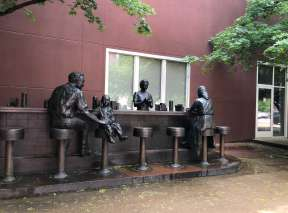 Bronze Sit-in Statue at Chester I. Lewis Reflection Square Park