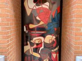 Hydrangeas in His Hand Alley Door by Aaron Jackson Bowman