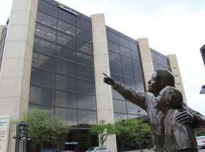 Bronze Sculpture of Mom and Kid Pointing at Kress Energy Center