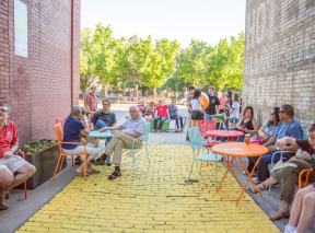 People Enjoying Open Patio Space At the Gallery Alley In Wichita, KS