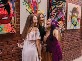 Three women taking a selfie in the Gallery Alley in Wichita, KS
