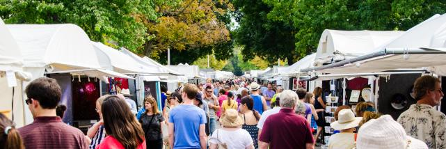 people checking out vendors at Fourth Street Festival during Labor Day in Bloomington