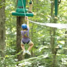 Zip-line at Treetop Quest - Explore Park